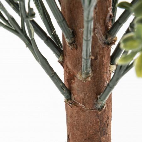 Focus arbuste artificiel buis sur tronc